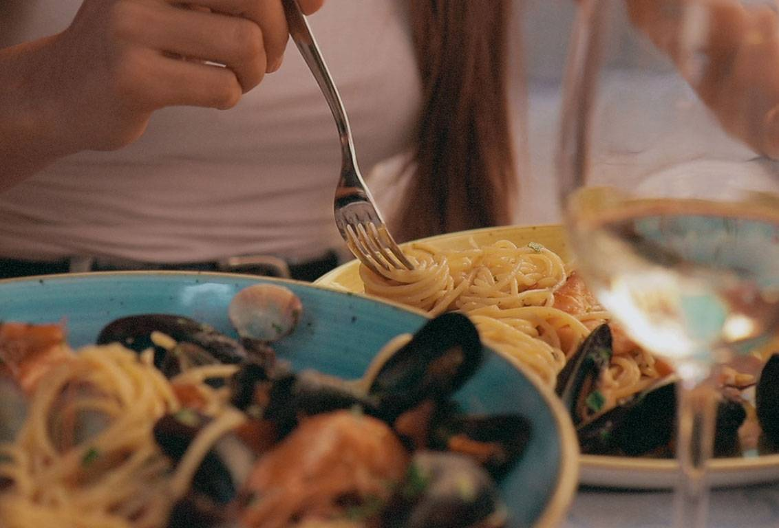 A fresh seafood typical lunch paired with italian Riviera wine will add a touch of magic to your cinque terre tour