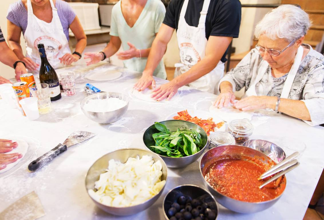 all the magic of our pizza cooking class in Tuscany is making it in our fascinating kitchen immersed in chianti countryside