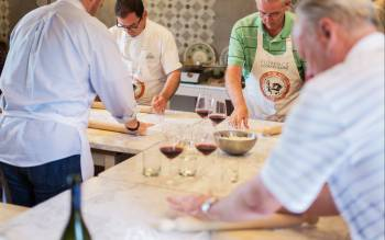 enjoy your cooking class: you will taste renowned Chianti Wine while you cook and eat your pizza